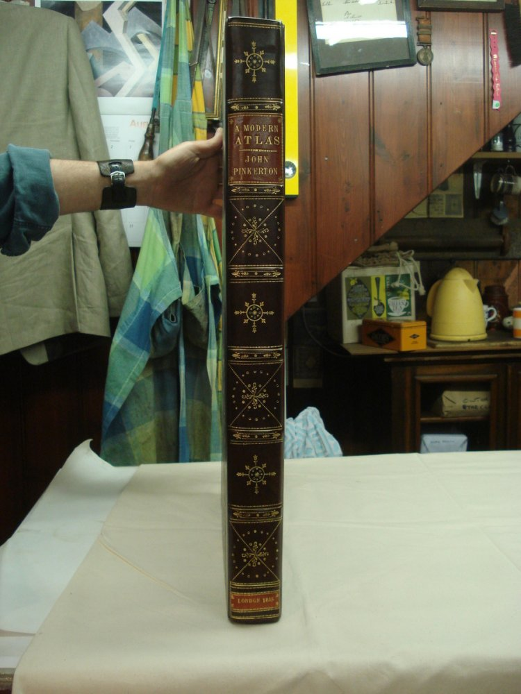 Large early 19thC Atlas bound in half calf with a Morroco label and onlays.